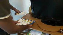 Vídeo da polícia mostra cofre com supostos ingressos ilegais da Rio-16