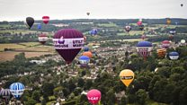 Balloons drift over Bristol during Fiesta