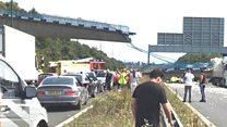 Footbridge collapses above M20