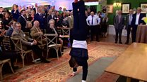 Gymnast Max Whitlock performs in suit for Prince Charles