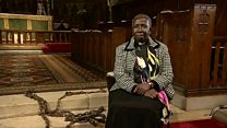 Black priest walks in 'slave' chains