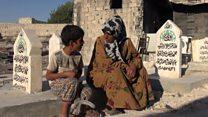 Aleppo family living in a cemetery.
