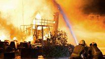 Huge fire engulfs wax-recycling factory