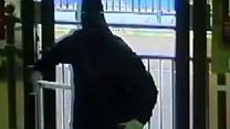 CCTV shows masked armed bank robbers