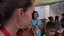 Teaching the violin to migrant kids