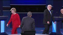 Trump pauses on moderator handshake