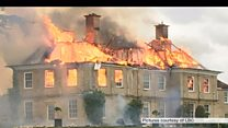 Country mansion gutted by fire