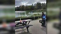 Bystanders rescue man and dog from car in lake