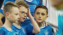 Bottle attack Rangers fan leads team out