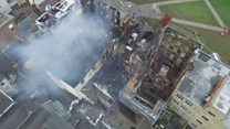 Drone footage shows smouldering hotel