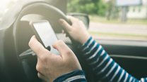 Using phones while driving is 'epidemic'