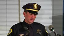 US officer fights back tears over shootings