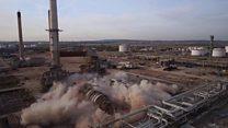 Refinery landmark crashes to the ground