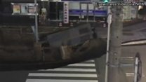 Sinkhole swallows busy Japanese street