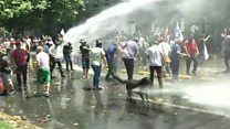 Protesters blasted with water cannon