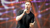 Gary Barlow hears the Take That For Hire auction total, live from his gym toilet!
