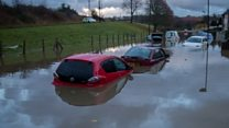 Cars submerged in winter storms