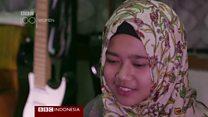 Meliani, malawan bully dengan jilbab dan gitar metal