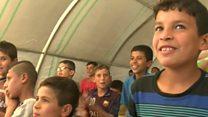 جنگ اور تشدد کی فضا میں قید عراقی بچے