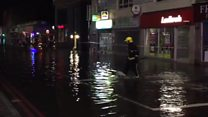 Burst water main turns road into 'river'