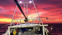 Dramatic sunset filmed on fishing boat