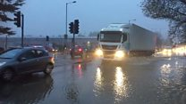 Burst water main causes A505 flood