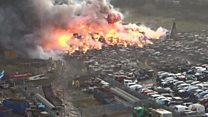 Drone shows estate scrapyard blaze