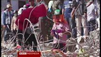 Pembersihan puing-puing gempa Aceh