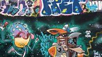Street artists paint giant alien