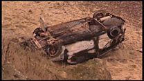 Burnt-out car found at bottom of cliff