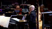 Boy battling leukemia conducts orchestra