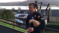 Calum McKillop plays the bagpipes