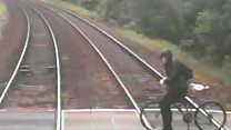 Cyclist's near-miss with train on CCTV
