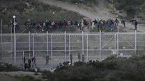 Migrants storm Spanish border fence