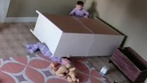 Boy, 2, saves twin from falling furniture