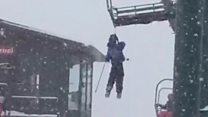 Dangling skier rescued from chair-lift