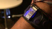 Armband controls artificial hand