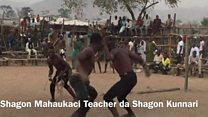 Dambe: Mahaukaci Teacher da Shagon Kunnari