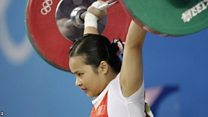 Cina dilarang ikut serta di kompetisi angkat beban internasional