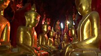 The cave filled with Buddha statues