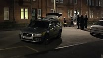 Riot police called to Glasgow flat