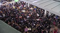 Calls of 'let them in' at airport protests