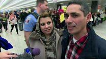 Families split as Trump ban enforced