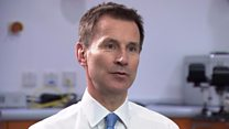 Hunt admits NHS problems, defends care policy