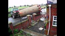 Slurry tank crashes through wall of house