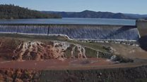 Tallest US dam overflows after heavy rain