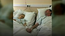Children share photo of terminally ill parents holding hands