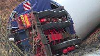 Overturned wind turbine lorry blocks road