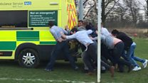 Watch: Rugby players rescue a stuck ambulance