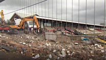 Football stadium demolition under way